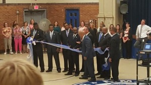 Cutting the ribbon for the Adopt A School Program